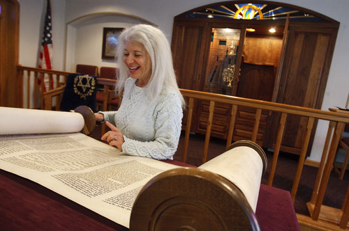 Leah Hogsten  |  The Salt Lake Tribune Congregation Brith Sholem president Judi Amsel scrolls through the Torah to Leviticus for the reading during Saturday service. The synagogue, built in 1921, is the spiritual home to 45 families in Ogden.
