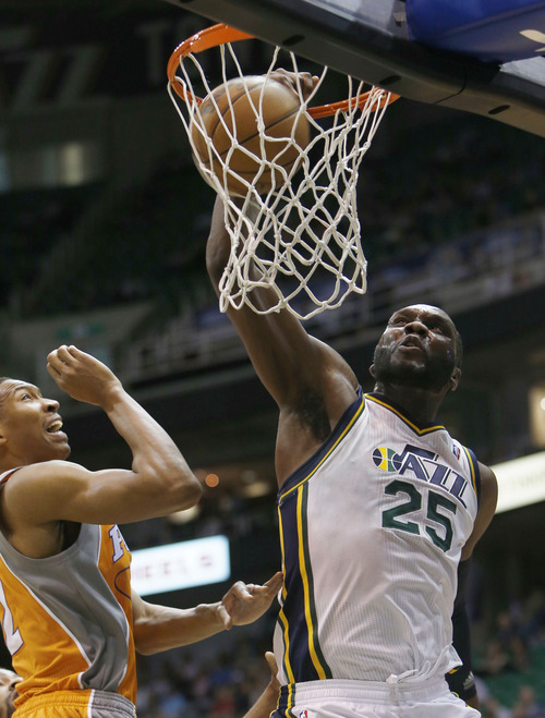 Steve Griffin | The Salt Lake Tribune   Utah's Al Jefferson slams home two during first half action in the Jazz versus Suns NBA game at EnergySolutions Arena in Salt Lake City, Utah Wednesday March 27, 2013.
