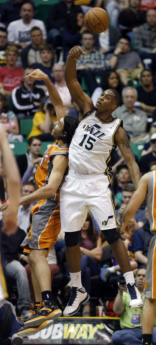 Steve Griffin | The Salt Lake Tribune   Utah's Derrick Favors, right,  taps the ball away from Suns forward Luis Scola during second half action in the Jazz versus Suns NBA game at EnergySolutions Arena in Salt Lake City, Utah Wednesday March 27, 2013.