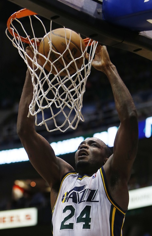 Steve Griffin | The Salt Lake Tribune   Utah's Paul Millsap dunks the ball during first half action in the Jazz versus Suns NBA game at EnergySolutions Arena in Salt Lake City, Utah Wednesday March 27, 2013.