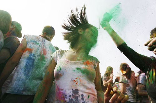 Francisco Kjolseth  |  The Salt Lake Tribune Josiane Souza of Brazil dances to the music as people throw bright colorful chalk made of edible maize during Holi, the Festival of Colors at Sri Radha Krishna Temple in Spanish Fork on March 24, 2012. The 2013 version happens Saturday, March 30.