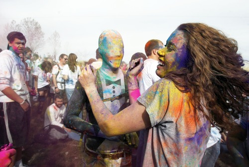Francisco Kjolseth  |  The Salt Lake Tribune Chris Vaughan, of Alaska, center, and Samantha Vehrs, of Provo, join revelers as they dance to the music and throw bright colorful chalk made of edible maize during Holi, the Festival of Colors at Sri Radha Krishna Temple in Spanish Fork on Saturday, March 24, 2012. The 2013 version of the event is Saturday, March 30.