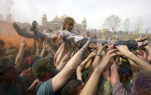 Francisco Kjolseth  |  The Salt Lake Tribune Revelers dance and body surf to the music as they throw bright colorful chalk made of edible maize during Holi, the Festival of Colors at Sri Radha Krishna Temple in Spanish Fork, Utah, Saturday, March 24, 2012. The 2013 version happens Saturday, March 30.