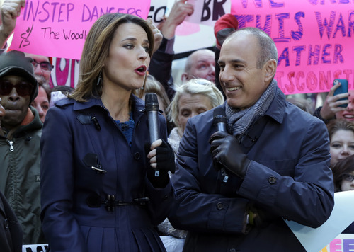 """Matt Lauer, co-host of the NBC """"Today"""" television program, appears with fellow co-host Savannah Guthrie during a segment of the show in New York's Rockefeller Center, Friday, March 29, 2013. A top NBC News executive said Wednesday the network is not considering replacing Matt Lauer as anchor of the """"Today"""" show despite reports that Anderson Cooper of CNN was approached about the job. (AP Photo/Richard Drew)"""