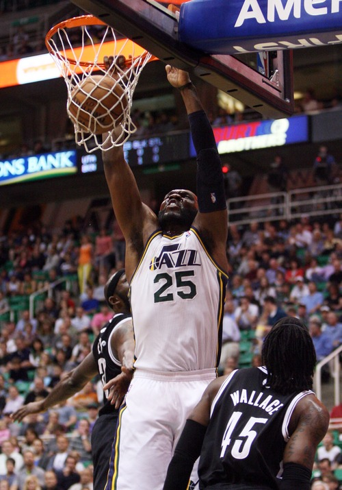 Kim Raff     The Salt Lake Tribune (middle) Utah Jazz center Al Jefferson (25) dunks the ball as (left) Brooklyn Nets power forward Reggie Evans (30) and (right) Brooklyn Nets small forward Gerald Wallace (45) defend during a game at EnergySolutions Arena in Salt Lake City on March 30, 2013.
