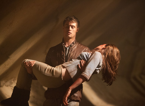 "This film image released by Open Road Films shows Max Irons and Saoirse Ronan in a scene from ""The Host."" (AP Photo/Open Road Films, Alan Markfield)"