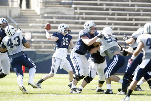 Chris Detrick  |  The Salt Lake Tribune Brigham Young Cougars quarterback Ammon Olsen (15) passes the ball  during the spring scrimmage at LaVell Edwards Stadium Saturday March 30, 2013.
