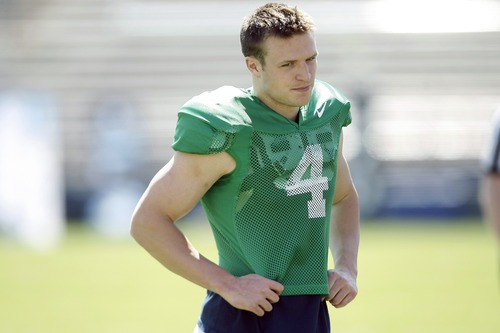 Chris Detrick  |  The Salt Lake Tribune Brigham Young Cougars quarterback Taysom Hill (4) during the spring scrimmage at LaVell Edwards Stadium Saturday March 30, 2013.