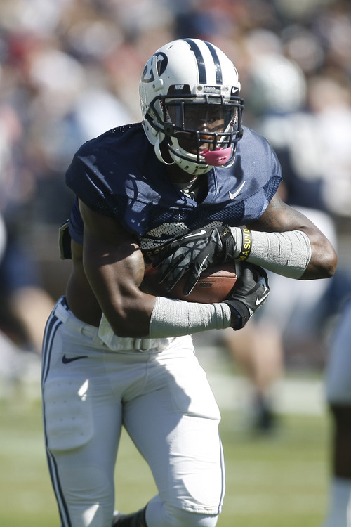 Chris Detrick  |  The Salt Lake Tribune Brigham Young Cougars running back Jamaal Williams (21) runs the ball during the spring scrimmage at LaVell Edwards Stadium Saturday March 30, 2013.