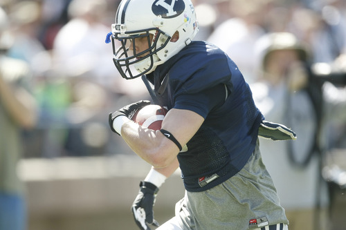 Chris Detrick  |  The Salt Lake Tribune Brigham Young Cougars wide receiver Kurt Henderson runs the ball during the spring scrimmage at LaVell Edwards Stadium Saturday March 30, 2013.