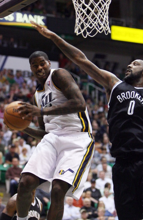 Kim Raff  |  The Salt Lake Tribune (left) Utah Jazz power forward Marvin Williams (2) rebounds the ball as (right) Brooklyn Nets center Andray Blatche (0) defends during the second half at EnergySolutions Arena in Salt Lake City on March 30, 2013.  The Jazz won the game 116-107.