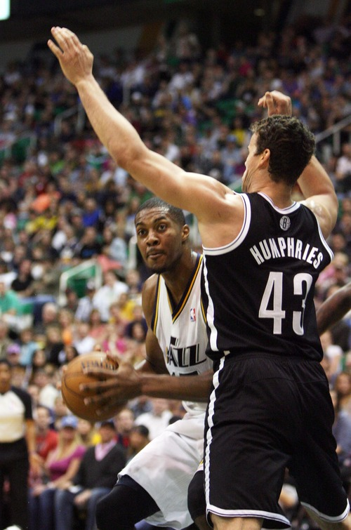 Kim Raff  |  The Salt Lake Tribune (left) Utah Jazz power forward Derrick Favors (15) attempts a shot as Brooklyn Nets power forward Kris Humphries (43) defends during the first half at EnergySolutions Arena in Salt Lake City on March 30, 2013.