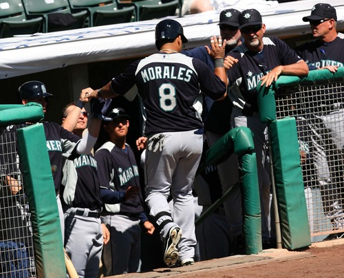 Leah Hogsten  |  The Salt Lake Tribune Seattle Mariners first baseman Kendrys Morales (8) celebrates his homerun with his teammates. Seattle defeated Colorado 4-3, Saturday, March 30, 2013, in the final exhibition tuneup of spring training as 15,411 spectators enjoyed the first Major League Baseball game played in Salt Lake City since 1970 at  Spring Mobile Ballpark.