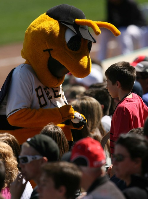 Leah Hogsten  |  The Salt Lake Tribune The Bees mascot signs autographs. Seattle defeated Colorado 4-3, Saturday, March 30, 2013, in the final exhibition tuneup of spring training as 15,411 spectators enjoyed the first Major League Baseball game played in Salt Lake City since 1970 at  Spring Mobile Ballpark.