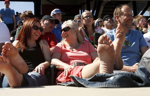 Leah Hogsten  |  The Salt Lake Tribune l-r Sarah Hopkins, Simone McInnis and Kevin McInnis kicked back at the game and put their feet up. Seattle defeated Colorado 4-3, Saturday, March 30, 2013, in the final exhibition tuneup of spring training as 15,411 spectators enjoyed the first Major League Baseball game played in Salt Lake City since 1970 at  Spring Mobile Ballpark.