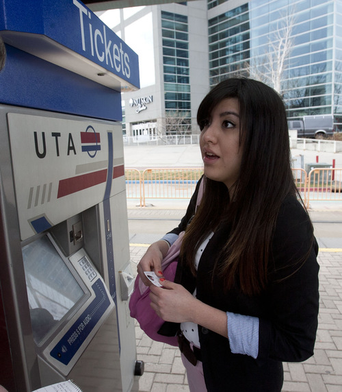 Steve Griffin | The Salt Lake Tribune   Claudia DeLa Peña recounted her change from the TRAX ticket machine, realizing it was less than she expected because of a fare hike. She figures that the extra cost adds up over time to the cost of a meal and may push her to drive to work.