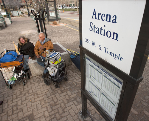 Steve Griffin | The Salt Lake Tribune   Karen Nies and Arley Martens wait at the Arena TRAX Station in Salt Lake City, Utah Monday April 1, 2013. Fares have increased for the train making it tough on low-income workers who depend on mass transit to get to workplaces.