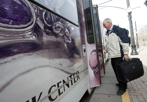 Steve Griffin | The Salt Lake Tribune   Grant Johnson boards his train at the Arena TRAX Station in Salt Lake City, Utah Monday April 1, 2013. Fares have increased for the train but Johnson, a state employee, has his pass subsidized.