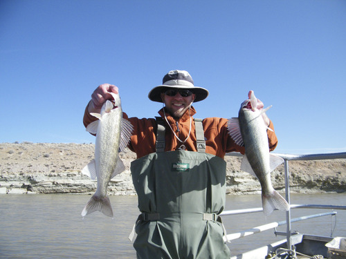 Jake Johnson holding two walleyes caught during nonnative fish removal. Courtesy photo