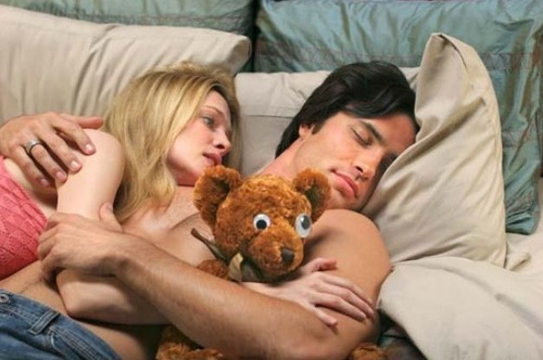 """Courtesy photo Emily (Heather Graham) cuddles with -- but doesn't have sex with -- her hot, Mormon boyfriend (Victor Webster) in """"Emily's Reasons Why Not."""""""