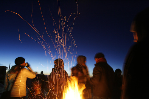 Scott Sommerdorf   |  The Salt Lake Tribune Fire pits kept early arrivals warm before the Easter sunrise service. Snowbird hosted the service at 11,000 feet of elevation on Hidden Peak, Sunday, March 31, 2013.