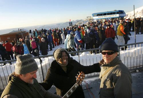 Scott Sommerdorf   |  The Salt Lake Tribune The Rev. Denise Elbert thanks musicians Kevyn Dern, left, and Rex Flinner after the Easter sunrise service at 11,000 feet of elevation on Hidden Peak, Sunday, March 31, 2013.