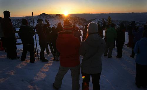 Scott Sommerdorf   |  The Salt Lake Tribune The sun peeks over the horizon prior to sunrise service at Snowbird. Snowbird hosted an Easter sunrise service at 11,000 feet of elevation on Hidden Peak, Sunday, March 31, 2013.