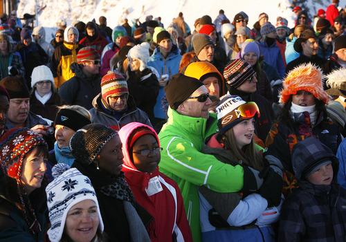 Scott Sommerdorf   |  The Salt Lake Tribune Attendees at the Snowbird Easter sunrise service listen to the Rev. Denise Elbert's message. Snowbird hosted an Easter sunrise service at 11,000 feet of elevation on Hidden Peak, Sunday, March 31, 2013.