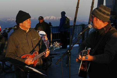 Scott Sommerdorf   |  The Salt Lake Tribune Musicians Rex Flinner, left, and Kevyn Dern played as Snowbird hosted an Easter sunrise service at 11,000 feet of elevation on Hidden Peak, Sunday, March 31, 2013.
