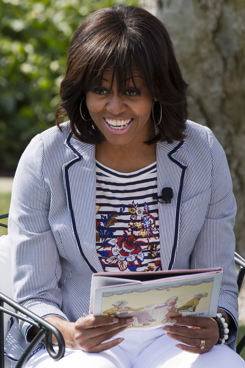 """First lady Michelle Obama smiles before reading the book """"Cloudy With A Chance of Meatballs"""" as part of the annual White House Easter Egg Roll, Monday, April 1, 2013,  on the South Lawn of the White House in Washington. (AP Photo/Jacquelyn Martin)"""