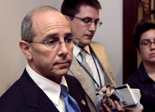 FILE - In this July 21, 2011 file photo, Rep. Charles Boustany, R-La., speaks on Capitol Hill in Washington. Millions of people who take advantage of government subsidies to help buy health insurance next year could get stung by surprise tax bills if they don't accurately project their income.  Starting next year, President Barack Obama's new health care law will offer generous subsidies to help millions of people buy private health insurance on state-based exchanges, if they don't already get coverage through their employer. The subsidies are based on income. The lower your income, the bigger the subsidy. (AP Photo/J. Scott Applewhite, File)