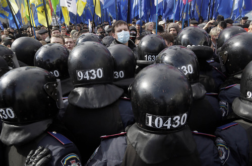 Ukrainian riot police guard the parliament building during an opposition rally in Kiev, Ukraine, Tuesday, April 2, 2013. Several thousand demonstrators rallied in Kiev to demand a mayoral election and to complain that the city was slow to clean up after last month's heavy blizzard that paralyzed the Ukrainian capital. (AP Photo/Efrem Lukatsky)