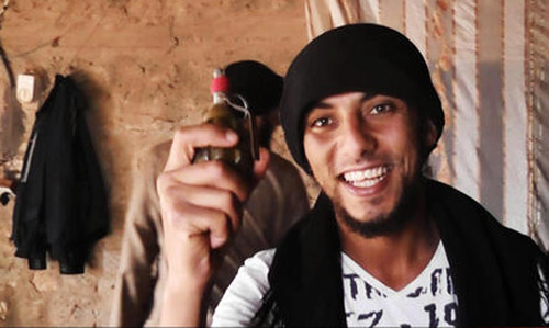 This undated image posted on a militant website purports to show a militant in the al-Jazeera region on the Iraqi side of the Syria-Iraq border. Last month, militants inside Iraq killed 48 Syrian government troops who had sought refuge from the war in their country _ an ambush that regional officials now say is evidence of a growing cross-border alliance between two powerful Sunni jihadi groups _ Al-Qaida in Iraq and the Nusra Front in Syria. Middle Eastern  intelligence officials said the jihadi groups are sharing military training compounds, logistics, intelligence and weapons as they grow in strength around the Syria-Iraq border, particularly in a sprawling region called al-Jazeera, which they are trying to turn into a border sanctuary they can both exploit.(AP Photo)
