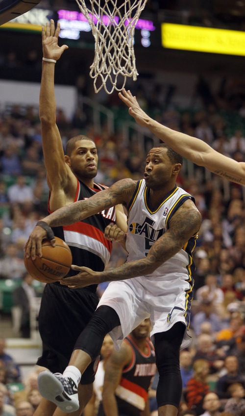 Rick Egan  | The Salt Lake Tribune   Utah Jazz point guard Mo Williams (5) tosses a pass backwards as Portland Trail Blazers small forward Nicolas Batum (88) defends, in NBA action, as the Jazz faced the Portland Trailblazers, at EnergySolutions Arena, Monday, April 1, 2013.