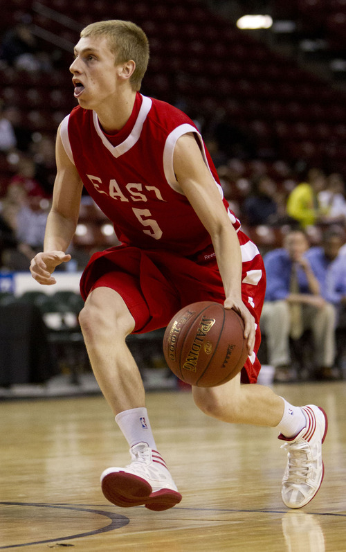 Trent Nelson  |  The Salt Lake Tribune It is not mandatory that young men leave when they are 18, as Utah basketball coach Larry Krystkowiak well knows. Two Salt Lake Valley LDS standouts, East High's Parker Van Dyke, pictured, and Brighton High's Brandon Miller, signed with Utah in November. Van Dyke originally planned to go on a mission this summer, but instead will play a season and then depart, partly because there's a chance he could be a major contributor next season.