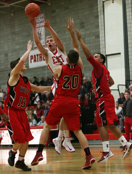 Kim Raff     The Salt Lake Tribune t is not mandatory that young men leave when they are 18, as Utah basketball coach Larry Krystkowiak well knows. Two Salt Lake Valley LDS standouts, East High's Parker Van Dyke, pictured, and Brighton High's Brandon Miller, signed with Utah in November. Van Dyke originally planned to go on a mission this summer, but instead will play a season and then depart, partly because there's a chance he could be a major contributor next season.