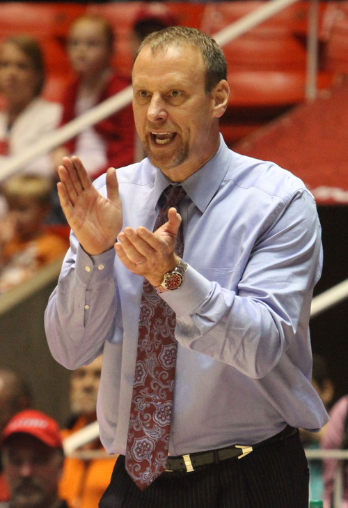 """Rick Egan    The Salt Lake Tribune  """"We don't have to wait until [they are] 19 anymore. It's just more flexibility for all parties now,"""" says Larry Krystkowiak, Utah men's basketball coach."""