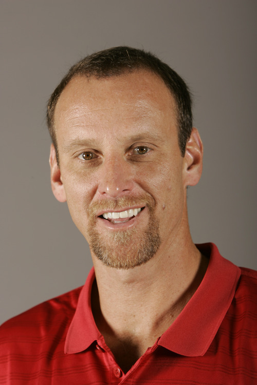 """""""We don't have to wait until [they are] 19 anymore. It's just more flexibility for all parties now,"""" says Larry Krystkowiak, Utah men's basketball coach. (AP Photo/Morry Gash)"""