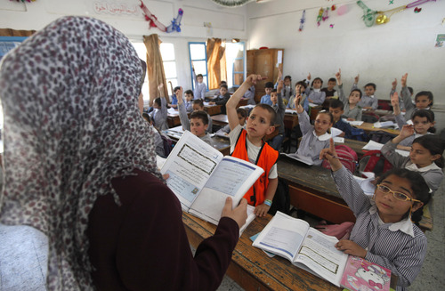 Palestinian kids attend a class at the UNRWA elementary school in Shati refugee camp in Gaza City, Tuesday, April 2, 2013. Gaza's Hamas-controlled parliament has passed a law requiring separate classes for boys and girls in public and private schools from the fourth grade. Currently, boys and girls are separated in grade seven in public schools, and private schools can set their own rules. (AP Photo/Hatem Moussa)