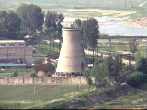 FILE - In this June 27, 2008 file photo from television, the 60-foot-tall cooling tower is seen before its demolition at the main Nyongbyon reactor complex in Nyongbyon,  also known as Yongbyon, North Korea.  North Korea vowed Tuesday, April 2, 2013, to restart a nuclear reactor that can make one bomb's worth of plutonium a year, escalating tensions already raised by near daily warlike threats against the United States and South Korea. The North's plutonium reactor was shut down in 2007 as part of international nuclear disarmament talks that have since stalled. The declaration of a resumption of plutonium production — the most common fuel in nuclear weapons — and other facilities at the main Nyongbyon nuclear complex will boost fears in Washington and among its allies about North Korea's timetable for building a nuclear-tipped missile that can reach the United States, technology it is not currently believed to have.  (AP Photo/APTN, File)