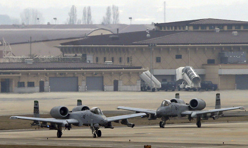 U.S. Air Force A-10 attack aircrafts wait to take off on the runway during their military exercise at the Osan U.S. Air Base in Pyeongtaek, south of Seoul, South Korea, Tuesday, April 2, 2013. North Korea vowed Tuesday to restart a nuclear reactor that can make one bomb's worth of plutonium a year, escalating tensions already raised by near daily warlike threats against the United States and South Korea. (AP Photo/Bae Jung-hyun, Yonhap) KOREA OUT