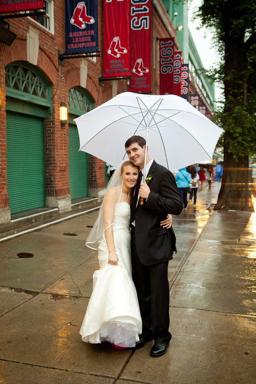 This image released by Giuliana Photography shows Melissa and Jeremy Cantarow on their wedding day in Boston. The Cantarows had their wedding reception at Fenway Park. (AP Photo/Giuliana Photography, Dana Giuliana)