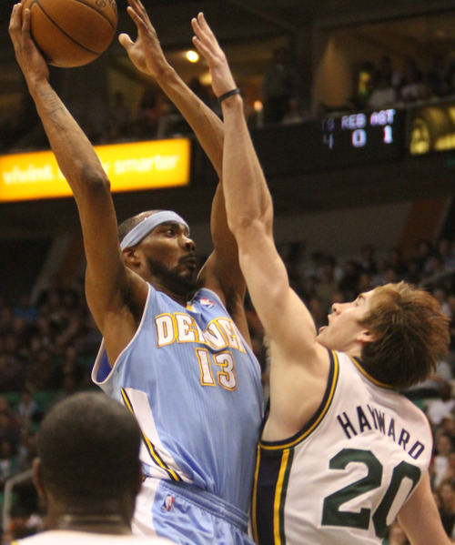 Rick Egan  | The Salt Lake Tribune   Denver Nuggets small forward Corey Brewer (13) shoots over Utah Jazz shooting guard Gordon Hayward (20)  in NBA action at the EnergySolutions Arena, Wednesday, April 3, 2013.