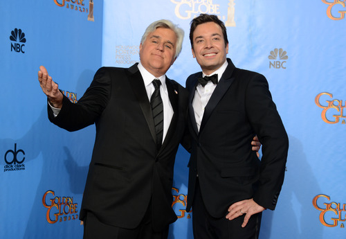 """FILE - This Jan. 13, 2013 file photo shows Jay Leno, host of """"The Tonight Show with Jay Leno,"""" left, and Jimmy Fallon, host of """"Late Night with Jimmy Fallon"""" backstage at the 70th Annual Golden Globe Awards in Beverly Hills, Calif. NBC announced Wednesday, April 3, 2013 that Jimmy Fallon is replacing Jay Leno as the host of """"The Tonight Show"""" in spring 2014. (Photo by Jordan Strauss/Invision/AP, file)"""