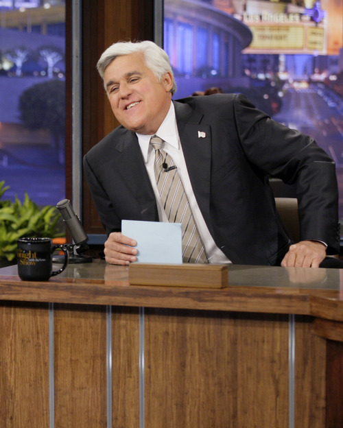 """This Oct. 24, 2012 photo released by NBC shows Jay Leno, host of """"The Tonight Show with Jay Leno,"""" on the set in Burbank, Calif. NBC announced Wednesday, April 3, 2013 that Jimmy Fallon is replacing Jay Leno as the host of """"The Tonight Show"""" in spring 2014. (AP Photo/NBC, Paul Drinkwater)"""