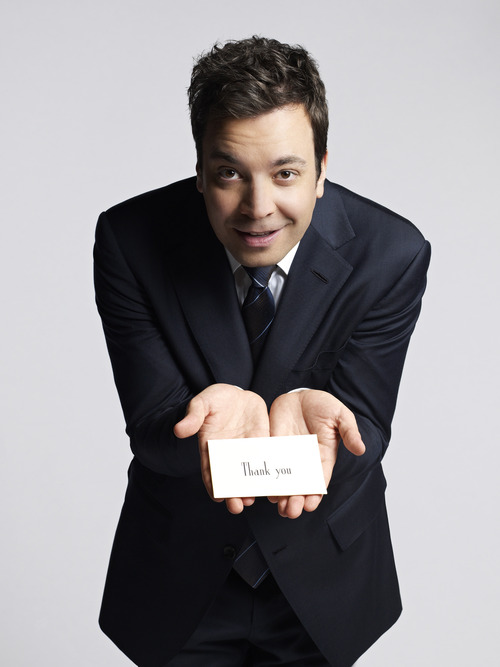 """This January 2013 publicity photo released by NBC shows Jimmy Fallon, host of """"Late Night with Jimmy Fallon,"""" holding a thank you note during a photo session in New York. NBC on Wednesday, April 3, 2013 announced its long-rumored switch in late night, replacing incumbent Jay Leno at """"The Tonight Show"""" with Jimmy Fallon and moving the iconic franchise back to New York. Leno will wrap up what will be 22 years of headlining the iconic late-night show in Spring 2014.  """"Saturday Night Live"""" producer Lorne Michaels will take over as producer of the new """"Tonight Show."""" (AP Photo/NBC, Mark Seliger)"""