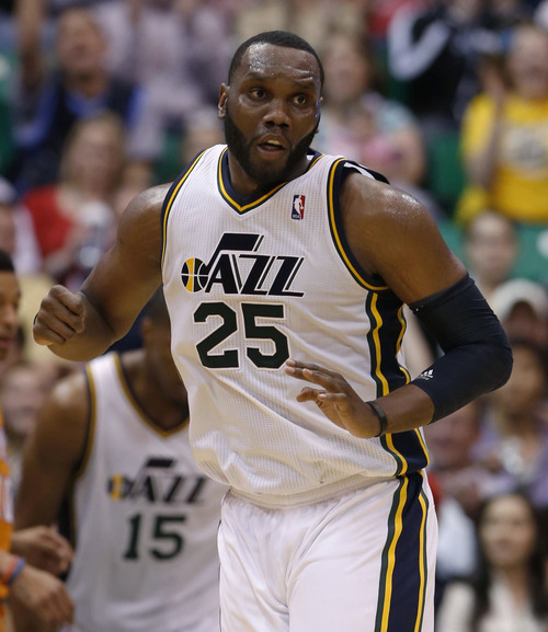 Steve Griffin | The Salt Lake Tribune   Utah's Al Jefferson spins around and heads up court after nailing a jumper during second half action in the Jazz versus Suns NBA game at EnergySolutions Arena in Salt Lake City, Utah Wednesday March 27, 2013.