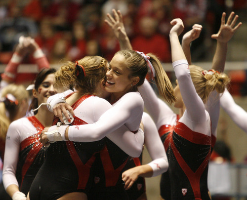 Rick Egan  | The Salt Lake Tribune   Tory Wilson is congratulated by Breanna Hughes, after her performance on the floor for the Ute's, in gymnastics action against The University of California, at the Huntsman Center, Saturday, February 9, 2013.