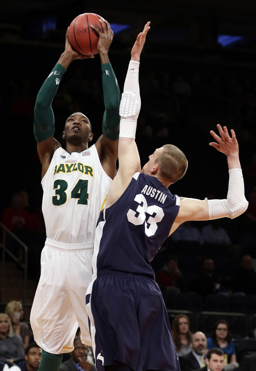 Baylor's Cory Jefferson (34) shoots over Brigham Young's Nate Austin (33) during the first half of an NIT semifinal basketball game, Tuesday, April 2, 2013, in New York. (AP Photo/Frank Franklin)