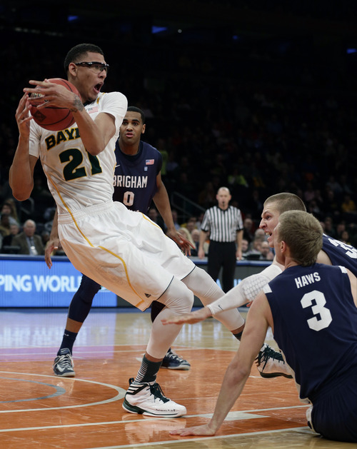 Baylor's Isaiah Austin (21) fights for control of the ball with Brigham Young's Tyler Haws (3) during the second half of an NIT semifinal basketball game Tuesday, April 2, 2013, in New York. (AP Photo/Frank Franklin)